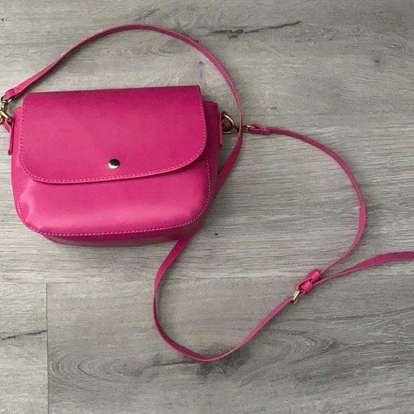 pink over the shoulder strap purse